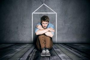 man in tiny apartment